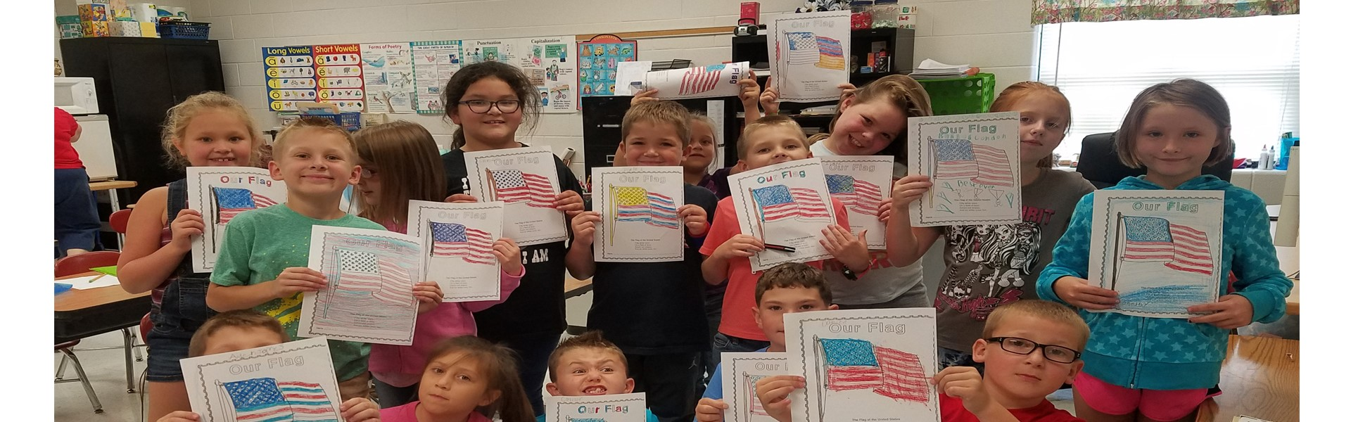 Mrs. Barbara Cox's class showing support for 911